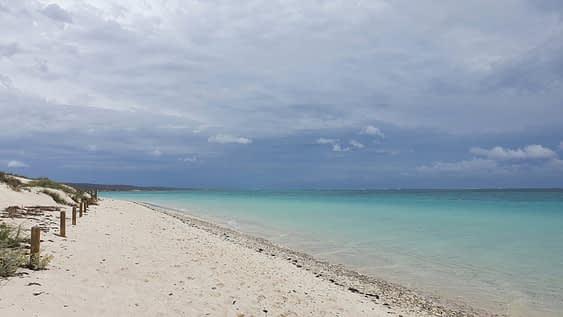 white sandy beach with turquoise blue coloured water