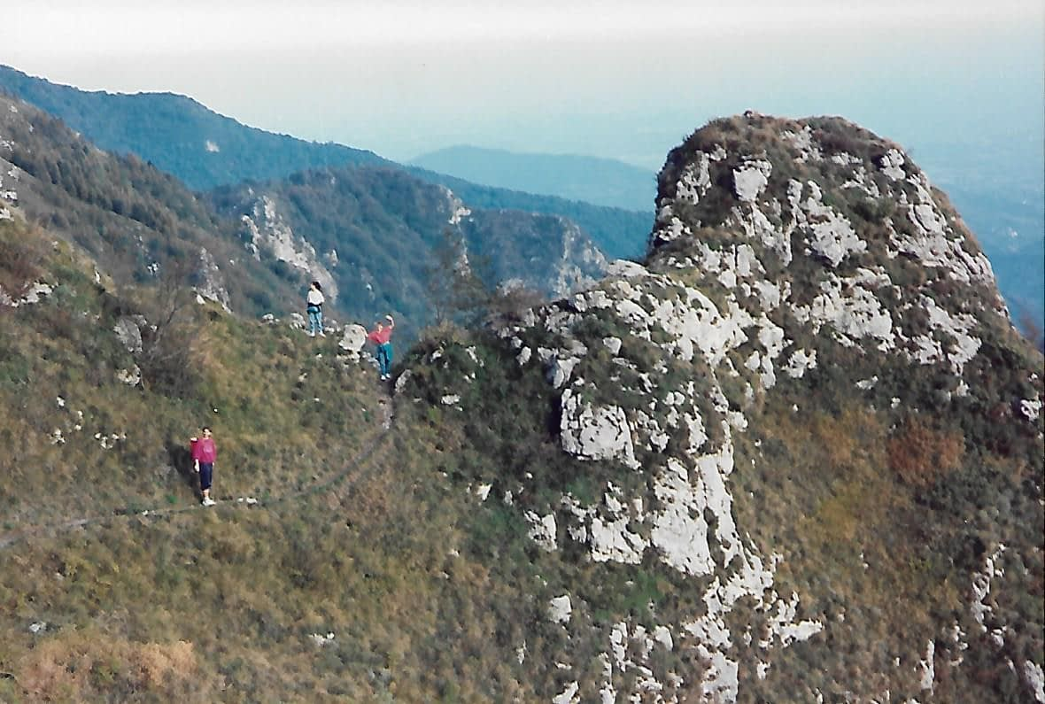 3 people hiking along a mountain top