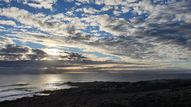 things to do in Yallingup such as watching sun set over ocean and sky dotted with clouds
