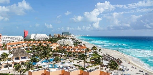 view of Cancun hotel strip on left and turquoise beaches on right