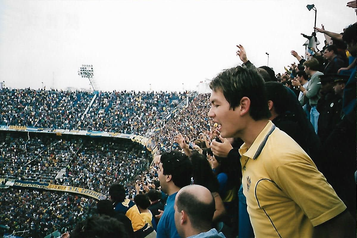 Boca Junior soccer fans yelling to their team from the stadiums third tier