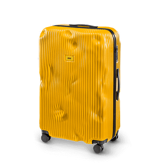 new travel trend - yellow striped suitcase pre-dented