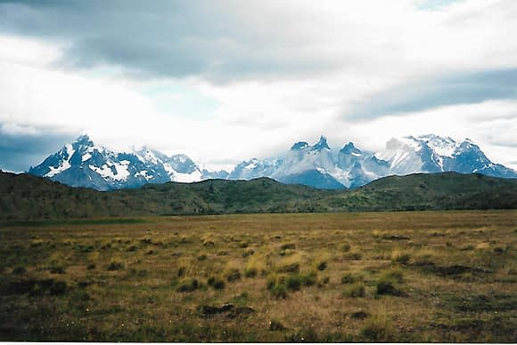 view of snow capped mountain range of Torres Del Paine hiking trails