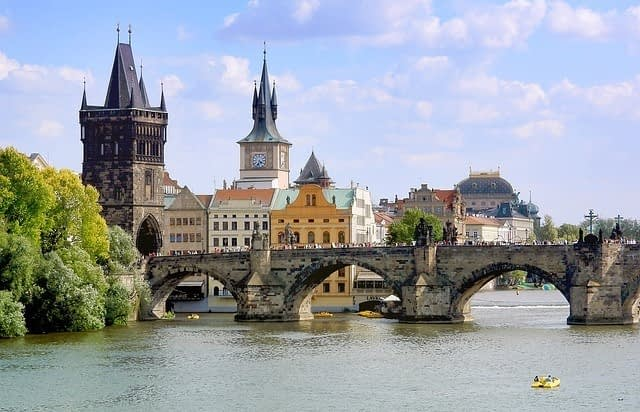 Prague city colour your travels with a historical skyline and Charles Bridge in the foreground