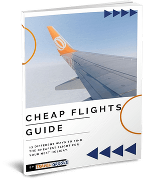 front cover of a guide book on how to find cheap flights with a photo of a plane wing and tip in the sky