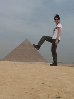 resting foot on giza pyramid thinking about travel groove