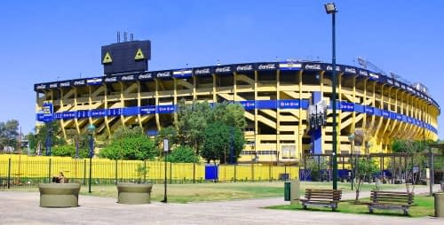 attending football matches in Buenos Aires at the la bombonera soccer stadium from a distance colouored in blue and yellow