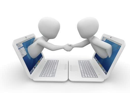 two stick figures poking out from a computer screen shaking hands
