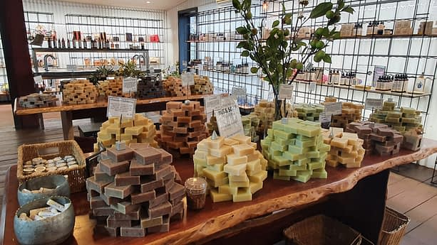 things to do in Yallingup like visiting a store with 3 tables of natural made soap stacked up in bundles