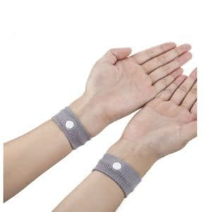 a pair of hands wearing grey wrist bands is the first cruise tips