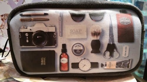 long haul flight tips showing a toiletry bag with images of essential travel items