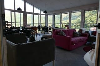 staying in backpacker hostels have lounge rooms with sofas and tables overlooking surrounding countryside